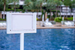 Empty of sign standing near a swimming pool Royalty Free Stock Image