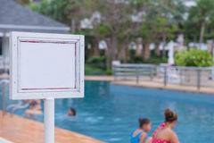 Empty of sign standing near a swimming pool Royalty Free Stock Photography