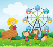 An empty signboard with kids near a ferris wheel. Illustration of an empty signboard with kids near a ferris wheel Royalty Free Stock Photography