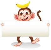 An empty signboard with a monkey at the back Royalty Free Stock Photo