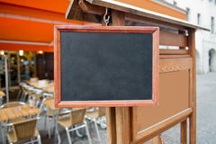 Empty signboard outside summer cafe. Picture can be used in advertisement and websites royalty free stock image