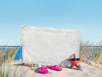Empty Signboard  and Summer Props on Beach Royalty Free Stock Photos