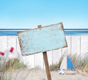 Empty Signboard and Wooden Fence on Beach Royalty Free Stock Photography