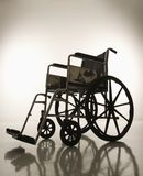 Empty silhouetted wheelchair. Stock Image