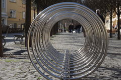 Empty silver metal bicycle stand with curved circles Stock Images