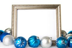 An empty Silver Picture Frame with Blue and Silver Christmas Ornaments Stock Photo