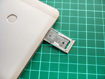 Empty SIM Card Tray for Nano SIM Card and Micro SIM Card. In Smartphone stock photos
