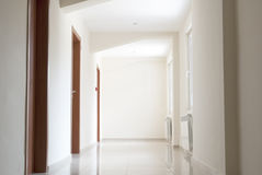 Empty simple hotel corridor Royalty Free Stock Photos