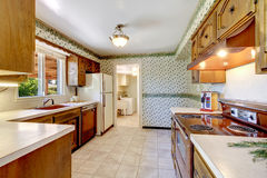 Empty simple old kitchen in American rambler. Royalty Free Stock Images