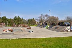 Empty Skate Park in Early Spring - All sorts of ramps. Empty skate park - early spring. No people. You can see all sorts of pipes - half pipe, ramp etc Stock Image