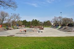 Empty Skate Park in Early Spring. Empty skate park - early spring. No people. You can see all sorts of pipes - half pipe, ramp etc. - graffiti included Stock Photo