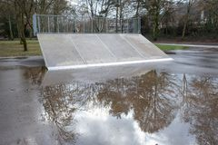 Empty skateboard ramp on a rainy day royalty free stock images