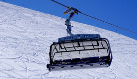 Empty ski cable car close up at snow mountains Titlis. Engelberg, Switzerland Royalty Free Stock Image