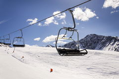 Empty ski chair lift on sunny day in Alps, Austria Royalty Free Stock Images