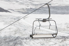 Empty ski lift above snow Royalty Free Stock Photography