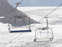Empty ski lift above snow Stock Photography