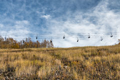 Empty ski lift in an alpine meadow Royalty Free Stock Photography
