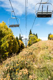 Empty ski lift in an alpine meadow Stock Photography
