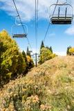 Empty ski lift in an alpine meadow Stock Photography