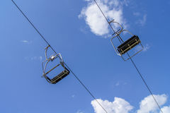 Empty ski lift with blue sky Stock Photo