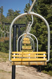 Empty ski lift chairs in a row. Many empty ski lift chairs in a row in the summer Royalty Free Stock Photos
