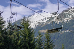 Empty ski lift in mountain scene Stock Image