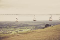 Empty Ski Lift Passing by Mountain during Daytime Royalty Free Stock Images
