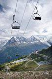 Empty ski lift seats. Along the Mont Blanc trail in France Stock Photos