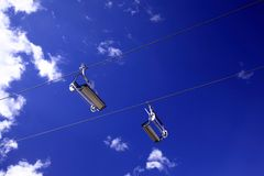 Empty ski lifts in the blue sky.  Royalty Free Stock Photos