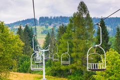 Empty ski lifts climb the hill. On a summer day Royalty Free Stock Photos