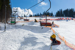 Empty ski lifts in a ski-resort in winter period. On a sunny day Royalty Free Stock Image