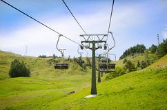 Empty ski resort chairlift in summer Stock Photos