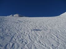 Empty ski slope. Snowy slope in the mountains with blue sky Stock Photo