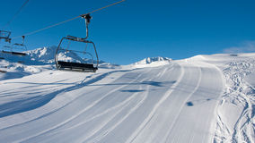 Empty skiing slope and chairlift Royalty Free Stock Images