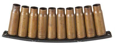 Empty SKS-45 carbine bullet shells in holder over white background. The empty SKS-45 carbine bullet shells in holder over white background Stock Photo