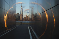 Empty Sky: Jersey City 9/11 Memorial at sunset shows One World Trade Center (1WTC), Freedom Tower through golden circle of light,  Stock Photo