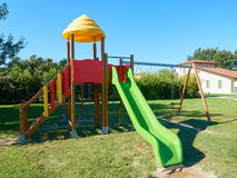 Empty slide swing at park outdoor Royalty Free Stock Photo