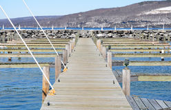 Empty slips late winter Seneca Lake showing straight dockboards Stock Photo