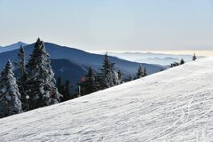 Empty slopes at Stowe Ski Resort in Vermont, view to the Mansfield mountain slopes