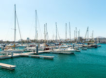 Empty slots in harbor, some boats, Spain Royalty Free Stock Photos