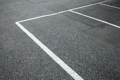Empty slots on urban parking lot, white marking Royalty Free Stock Photo