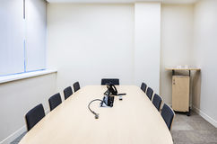 Empty small bright meeting room Stock Photos