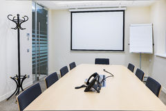 Empty small bright meeting room Stock Photo