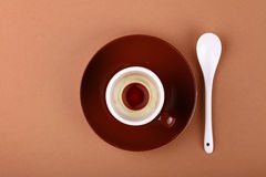 Empty small brown cup of black coffee on parchment Royalty Free Stock Photo