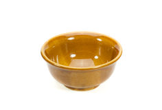 Empty small yellow brown serving bowl isolated. Empty small yellow brown serving bowl isolated on white background Royalty Free Stock Image