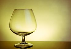 Empty snifter of brandy in elegant typical cognac glass on table Stock Photography
