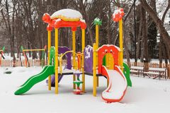 Empty snow children playground in the park in winter time Royalty Free Stock Photo
