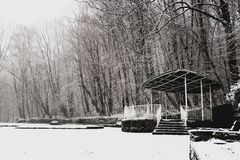 Empty snow-covered arbour in an empty Park. Empty snow covered arbour in an empty winter Park Royalty Free Stock Photography
