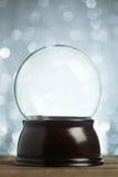 Empty snow globe. Christmas background Stock Photos