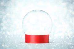 Empty snow globe. On glitter background Royalty Free Stock Image